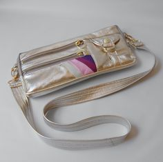 I've been coveting this handbag designer's purses on Etsy for a LONG time.  I might finally have to buy one.  This is awesome!  SALE - 9 pocket Vigga clutch/hand bag in gold foil. $98.00, via Etsy.