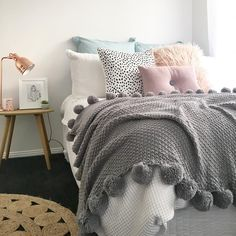@stylingbytiffany on Instagram: bedroom, colourful bed, pom pom throw, button cushion