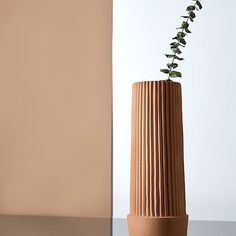 Umbra Shift pleated vase - a modern approach to terracotta. Design by MSDS.