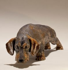 'Mini wired-haired dachshund' by Nick Mackman. Low fired raku clay. £1000. http://www.lyndhurstgallery.co.uk/gallery_detail.asp?id=1735#
