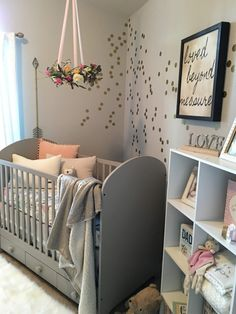 Project Nursery - The white seersucker curtains add just the right amount of soft light into the room. The metallic arrows on either side of the window are from Hobby Lobby
