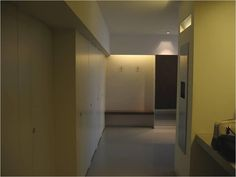 The lighting in this ladies toilet is very dark, the doors to the WC compartments on the left  are finished flush and only a small recessed handle distinguishes their existence.    Floors and walls have very little colour contrast. A mirror at the end of the room adds to confusion.   Image courtesy of Sandra Manley, UWE. Distinguish Between, Colour Contrast, Confusion, Floors, Toilet, It Is Finished, Walls, Handle, Mirror
