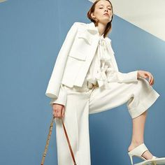 White can do wonders for a fresh office look. On summer days, add a textured top and sophisticated sandals #AlexanderMcQueen #VictoriaBeckham #Marni #Chloe #GianvitoRossi #mytheresa #covetme