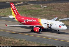 VietJet Air (VN) Airbus A320-214 VN-A680 aircraft, with the stickers ''DisneyLive! & Enjoy Flying'' on the airframe, skating at Vietnam Ho Chi Minch City Tan Son Nhat I nternational Airport. 24/01/2015.