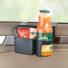 """NEW! Car Mult-Box - Cars never have enough cup holders. Drinks and odds and ends can be safely stored and at hand. The plastic holder simply attaches to the lip of the window (fits up to 2"""" wide lip). Great for small children who can't reach standard drink holders. Fits round bottles and juice boxes. Ideal for road trips. (Product Number AP5708) $12.98 CAD"""