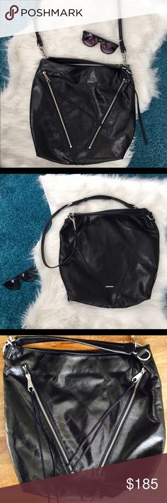 """NWOT Rebecca Minkoff Moto Leather Shoulder Bag Slouchy and accented with leather tassels, this beautiful bag is both super chic and versatile. It's roomy enough for all your work and gym essentials, but won't look out of place at dinner. New ( never worn) without tags.  15.5"""" H x 15.5"""" W x 5"""" D Top handles with 5"""" drop Custom silver hardware Main snap closure 2 exterior zip pockets 1 interior zip pocket, 3 interior slip pockets Rebecca Minkoff Bags Hobos"""