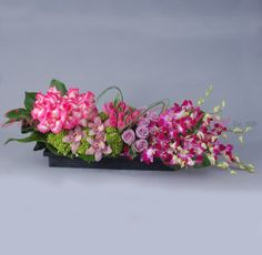 Sonny Alexander Flowers, tabletop arrangement, orchids roses tulips and hydrangea flowers, dinner table centerpiece, valentines day gift