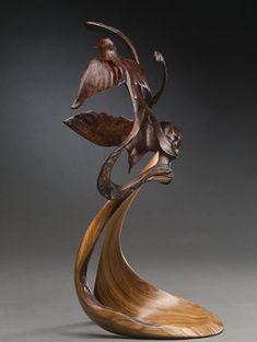 J. Christopher White - Carved from one piece of pure Bird's Eye Mesquite Burl and mounted on Juniper