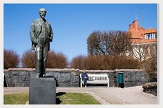 Spring came with the sun, finally....  Statue of auther Juhani Aho1861-1921. In Eira Helsinki Finland