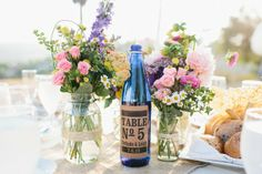 mason jar centerpieces, like this idea for table numbers on old bottles