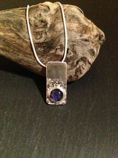 Hey, I found this really awesome Etsy listing at https://www.etsy.com/listing/215182188/iolite-silver-necklace-hammered-silver