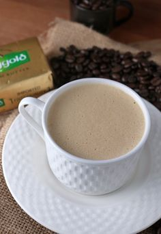 bulletproof coffee: 2 cups coffee, 2 tbsp grass-fed unsalted butter, 2 tbsp organic coconut oil or mct oil, 1 tbsp organic heavy cream, 1 tsp vanilla, a dash or 2 of cinnamon. mix with ninja or other blender.