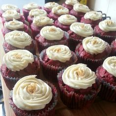 Red velvet cupcakes with cream cheese frosting and gold edible glitter
