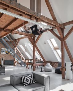 www.littlerugshop.com Other than the bedroom the open space floor plan of this home designed by #CunsStudio allows for maximum interactivity between the homeowner and guests even from the built-in #hammock! \\ Photo by Hanna Długosz by designmilk