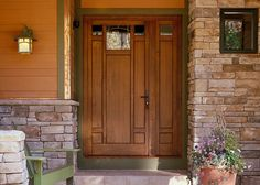 """Welcoming """"Craftsman"""" door from Better Homes & Gardens. I love the side panel with the window. It just adds enough width for interest. The door also looks good set in the surrounding stone."""