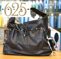 The classical black handbag with a twist! A fabulous tie adds a stylish touch! www.salon625.com