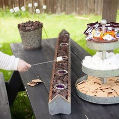 S'mores bar in the backyard? Yes please! {This #CapturingTheSeason is perfect for your Summer Bucket List. Your family will love it... I should know, because we did ours tonight!} We got the long container at a flea market and the bucket in the background from @magnoliamarket. It's called the Mini Olive Bucket. #magnoliamarket