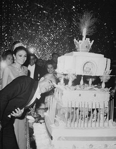 The shah of Iran blows out the 48 candles on his birthday cake in Tehran. His queen, Empress Farah, watches. The shah crowned himself and Farah earlier. Emilie Jolie, Pahlavi Dynasty, Farah Diba, The Shah Of Iran, Persian Architecture, Sassanid, Persian Pattern, Tehran Iran, Mosaic Garden