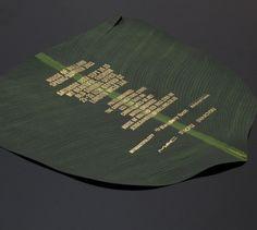 palm/banana leaf with gold wording destination wedding invitation design inspiration - fashion week invitation inspiration