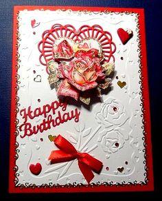 Carte créée le 17.02.2015 rouge et blanche. Embossage Nellie's Vintasia die coeur avec roses Le shu montées en 3D et pailletées. Perles, coeur en fimo et noeud satin
