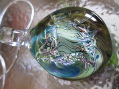 Lampwork glass necklace pendant by Eighth Planet Glass