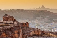 The city of Jodhpur, India (Blue City) and distant Umaid Bhawan Palace, Located in the Thar Desert.