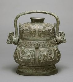 China - Covered Ritual Wine Vessel (You) with Decoration of Confronting Birds - Zhou dynasty, Western Zhou period, c. 11th century BC-771 BC - Cast bronze with blackish patina; with a dedication by Lady Geng Ying inscribed on both the vessel floor and lid interior
