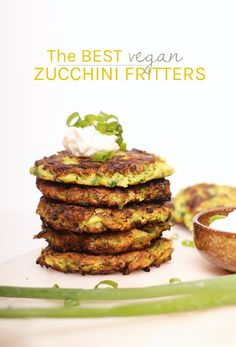 These warm and zesty vegan zucchini fritters! Made in just 20 minutes, they make the perfect breakfast, lunch, or dinner. Top with vegan sour cream and fresh green onions for a simple and delicious meal. Vegan Zucchini Fritters, Vegan Zucchini Recipes, Vegan Dinner Recipes, Vegan Foods, Vegan Dinners, Whole Food Recipes, Healthy Recipes, Fit Meals, Healthy Zucchini