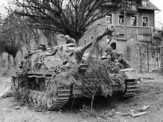 Germans hiding a StuG IV anti-tank gun.