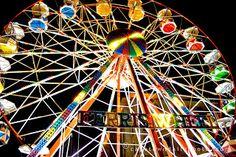 a ferris wheel full of vibrant colors
