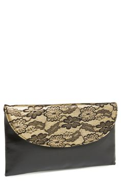 Obsessed with the lace detail on this gold and black clutch.