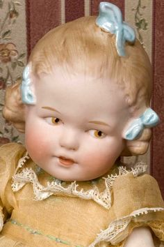 """9"""" Heubach All Bisque girl with three molded bows. Hard to find!"""