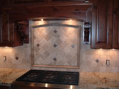 Custom Kitchen Back splash that John Martin designed and set to see more photos  and tile ideas go to my web site at www.protouchtile.com