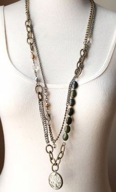 "Kerry - For the girl who loves to chat by candle light on the patio late into the night. Mixed metal chains with hand wrapped beads, semi precious stones, crystals and vintage pewter pendant. Length: 33"" http://sheeraddictionjewelry.com"