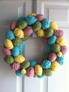 """Easter!~~ way to view scrap yarn, use a """"U"""" pin to attach to foam  wreath-from Dollar Tree, I wonder  if using big pearl headed corsage pins would hold rolls of ribbon to a foam wreath....must try this."""
