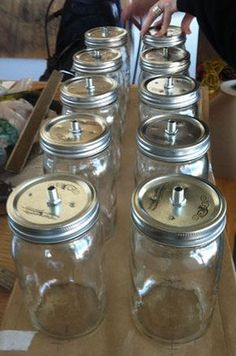 Jar Chandelier Jar Chandelier Instructions - I have blue, green and now PURPLE Ball jars, can't wait to make these!Jar Chandelier Instructions - I have blue, green and now PURPLE Ball jars, can't wait to make these! Diy Mason Jar Lights, Mason Jars, Mason Jar Chandelier, Diy Chandelier, Mason Jar Lighting, Mason Jar Light Fixture, Wagon Wheel Chandelier, Chandeliers, Mason Jar Projects