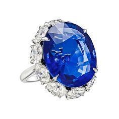 22.32 Carat Sapphire & Diamond Ring Ceylon sapphire and diamond ring, centering on an oval-shaped sapphire weighing 22.32 carats, with an oval-shaped diamond surround weighing approximately 4.10 total carats, mounted in platinum.
