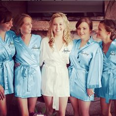 Mrs. McKenna in Classy Bride's white satin bridal robe and her maids in Sky Blue. Photo Courtesy of Aaron MacDougall Photography.