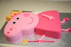Peppa Pig...cake supplied, carved and iced by Amanda's Cake Art