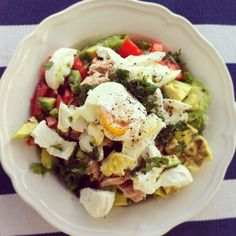 Tuna, avocado, tomato, mozzarella, poached egg, lettuce, and rocket salad. Lunch reminder yummmm