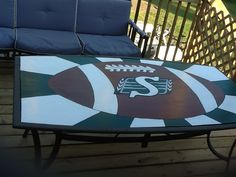 Saskatchewan Roughrider table  - made from an existing table base, with a painted logo on plywood
