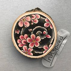 Wood slice with an original drawing of cherry blossoms