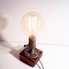 Globe style Edison Bulb table lamp in Red Mahogany - Antiqued finished wood base - Steam punk style light - New york loft industrial style Steampunk Table, Lampe Steampunk, Edison Bulb Table Lamp, Edison Lampe, Pipe Lighting, Cool Lighting, Room Lamp, Desk Lamp, Pipe Lamp