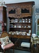 Stunning Antique French Oak Dresser early 1800's. Exquisite rare piece. Beautiful detailed carvings throughout with mesh doors up top and shelving for books or porcelain also. Bottom part is great for wicker baskets etc.  This stunning dresser is a true provincial piece which can only be found in the south of france.