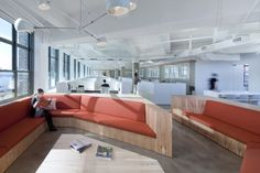 Horizon Media Office, NYC - cool light fixture and nice juxtaposition of white with a little wood/color