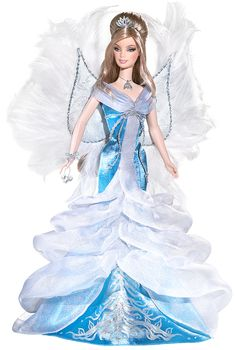 2008 Angel Barbie® Doll | Barbie Collector :: Dressed in an icy blue and white gown, 2008 Angel Barbie® doll is a heavenly vision. Delicate white wings accented with feathers add to her ethereal appeal. With serene face paint and glittery accessories, she's sure to warm your heart! Release Date: 6/1/2008