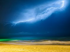 Lightning, Iran by AmirAli Sharifi. After three years I went to visit my family in Iran. We traveled to the city of Mahmood Abad in the north of Iran and had the most amazing time together. One night as I was walking on the shore of the Caspian Sea with my sister, I saw distant lightning. I ran to the hotel, grabbed my camera and tripod, and came back. I took many long exposures, but it was only in the second shot that I captured the biggest, most beautiful, and the last lightning of that…