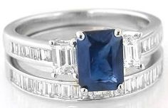 Diamond and Sapphire Engagement Rings___MJS Comment: The elegant, high quality emerald cut blue sapphire has a rich royal navy blue color and its shape plays off of the icy emerald cut diamonds that flank each side.