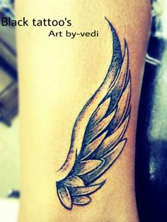 Small wing tattoo