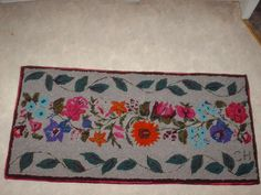 used a lot of velour in this 2'x4' rug.  The back ground is a wool blanket. Made by Carmen Hall using a Rug Crafters tool.  Finished November 2015